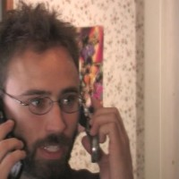 Producer Jonathan Lacocque handles two phone calls at once (he's good)