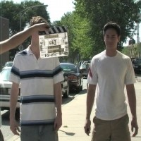 Director Eric Battersby slates a shot with Nick Lewis and Jason Abustan