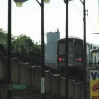 An EL train leaves the station at Cailfornia and Lake