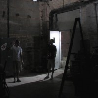 Jason and Jonathan light a scene in another area of the warehouse set