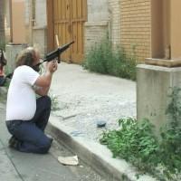 Gun expert Matthew Stratton prepares for a special effects shot