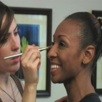 Makeup Artist Ruth Condren touches up actress Traci Prince
