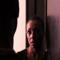 Tomika (Traci Prince) answers the door to find Tyrone (Harold Dennis)